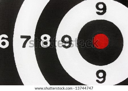 Black and white dartboard with red bullseye