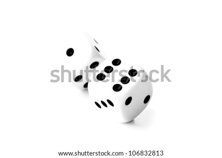 Black and white dices in motion against a white background