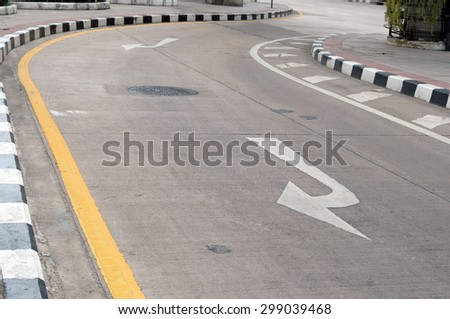 Black and White Directional Arrow on Asphalt