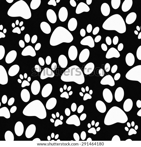 Black and White Dog Paw Prints Tile Pattern Repeat Background that is seamless and repeats - stock photo
