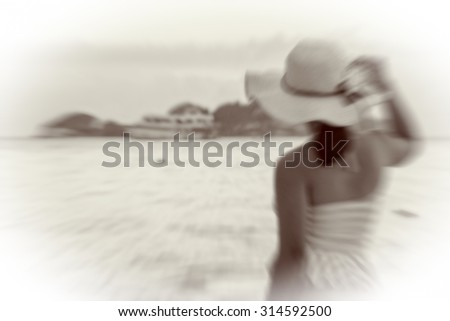 Black and white effect vintage blur radial style for background, Tourist woman on the beach and sea at Miang island in Mu Koh Similan National Park, Phang Nga Province, Thailand