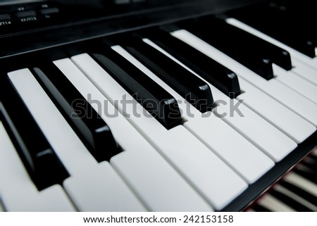 Black and white electric piano keys. Synthesizer - stock photo