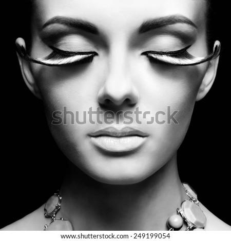 Black and white fashion portrait of beautiful lady with eyelashes  - stock photo