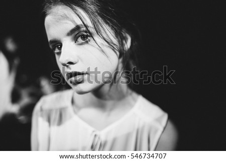 black and white fashion portrait of  young girl with beautiful make-up