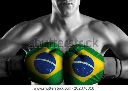 Black and white fighter with Brazil color gloves - stock photo