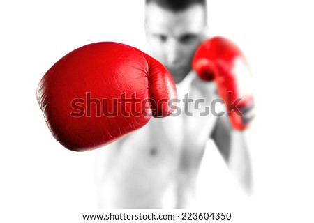 Black and white fighter with red gloves. Bokeh. - stock photo