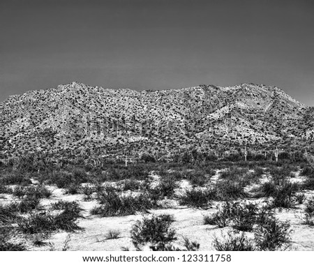 Black and white film shot image of a desert mountain - stock photo
