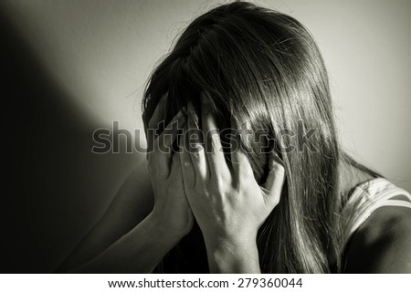 Black and white filtered of sad girl,social problem concept. - stock photo