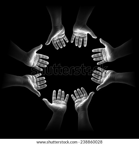 Black and white four people open empty hands with palms up over black background. World Mental Health Day concept. International Volunteers Day, International Human Solidarity Day concept. - stock photo