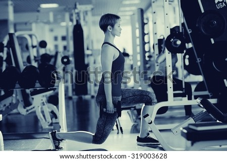 Black and white girl gym workout - stock photo