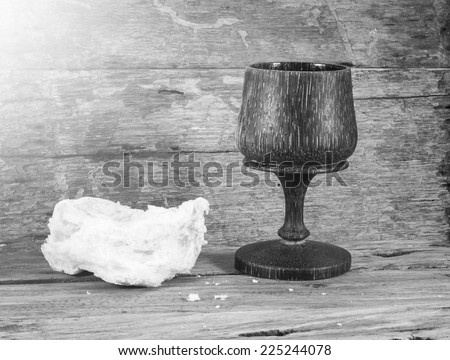 Black and white glass of wine and Loaf of bread in eucharist of christian. Forgiveness, Faith, Last Supper, Easter Sunday, Maundy Thursday, Good Friday concept. - stock photo