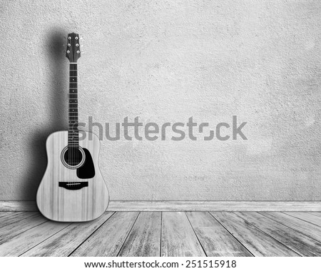 Black and white. Guitar in  white room. - stock photo