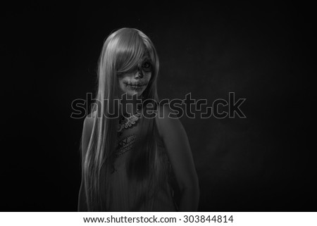 Black and white. Halloween portrait of young woman with sugar skull makeup