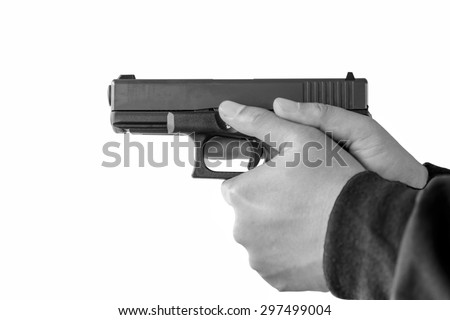 black and white hand holding a gun on white background (soft fogus) - stock photo