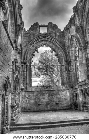 Black and white HDR shot of the inside of the choir in Lincluden Collegiate Church (also know as Priory or Abbey) in Dumfries.