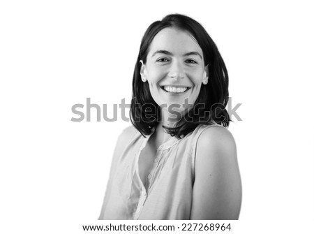 Black and White Head and Shoulders Portrait of Smiling Woman with Dark Hair in Studio - stock photo