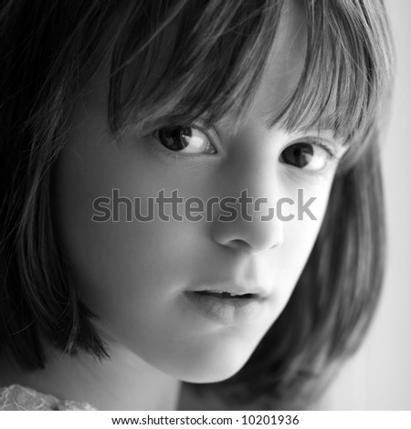 Black and white (head shot)  portrait of a young girl.