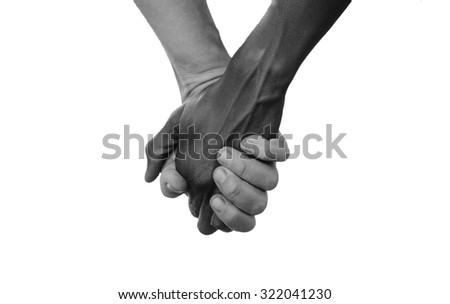 Black and White Hold Hands for Africa Union Peace Love. A beautiful shot with lots of possible background symbols. No to Racism! White woman holds hands with a little native African girl, in Mali.  - stock photo