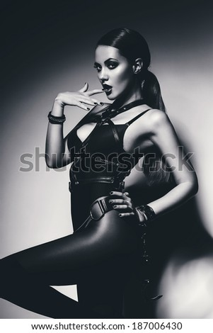 black and white hot woman biting finger - stock photo