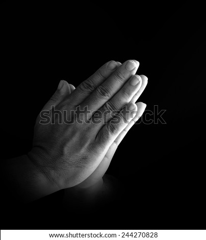 Black and white human hands of pay obeisance. Pray for support, Amazing Grace, Worship, Forgiveness, Mercy, Humble, Evangelical, Hallelujah, Thankful, Praise, Redeemer, Amen, Trust, Faith concept. - stock photo