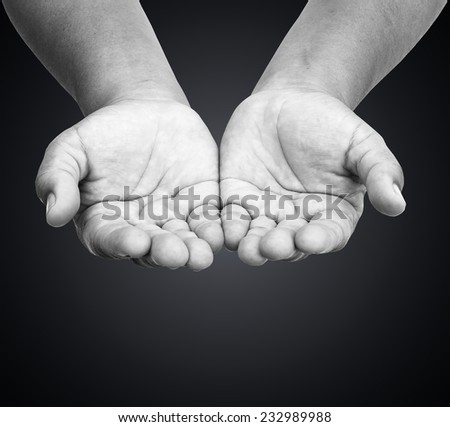 Black and white human hands of prayer.