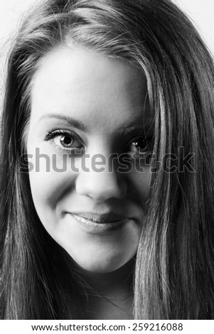 black and white image of a beautiful young woman looking straight into the camera