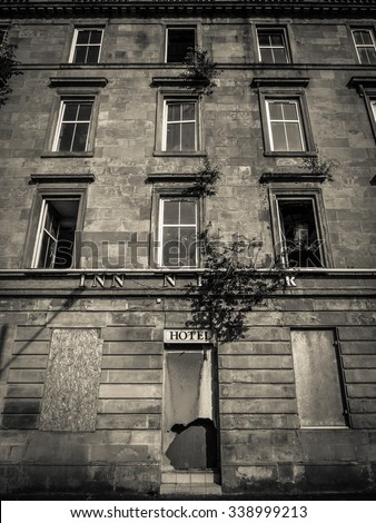 Black And White Image Of A Derelict And Boarded Up Hotel