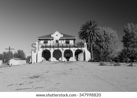 Black and white image of a Spanish style building in the California desert, USA. - stock photo