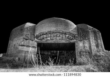 Black and white image of an WW2 bunker in the dunes of Ijmuiden, The Netherlands - stock photo
