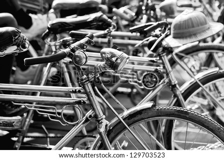 Black and white image of bike taxi parking on the street