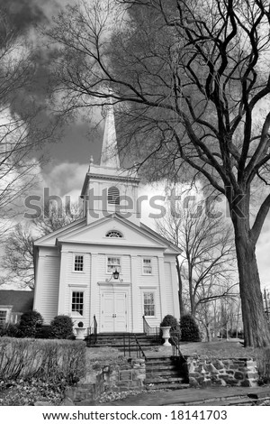 Black and white image of classic style New England church.