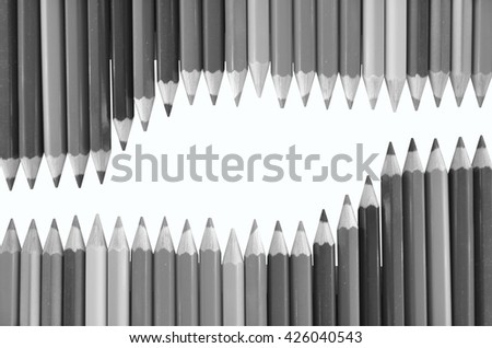 Black and white image of colored pencils