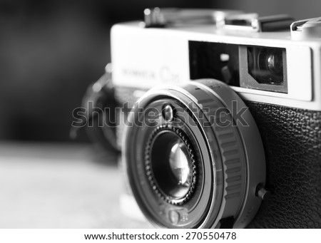 Black and White image of film camera that had been popular in the past - stock photo