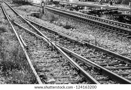 Black and white image of railway track crossover