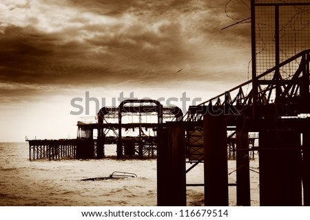 Black and white image of the remains of Brighton West Pier after fire, England, UK