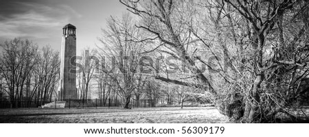 Black and white image of the William Livingstone Memorial Lighthouse on Belle Isle island park on the Detroit River in Detroit, Michigan. - stock photo