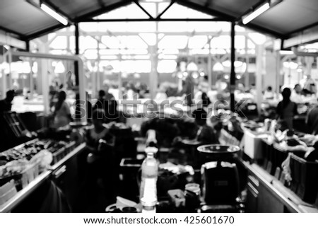 Black and white image of wet market with intentional blur effect. - stock photo