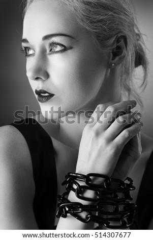 black and white image of woman wearing latex shot in the studio