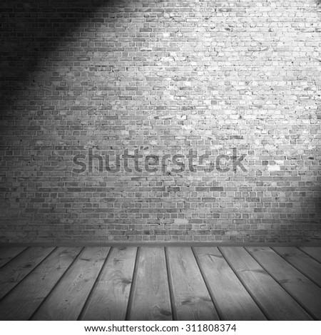 black and white interior background, brick wall and wooden floor - stock photo