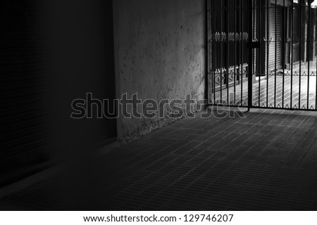 Black and white interior enclosed by a fence