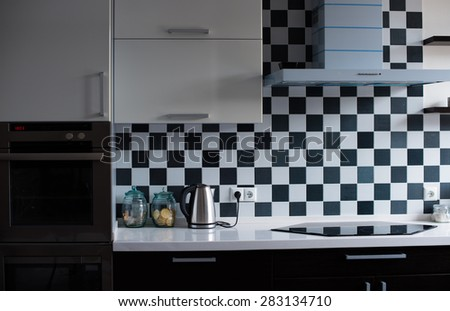 Black and white interior of a modern kitchen, close-up