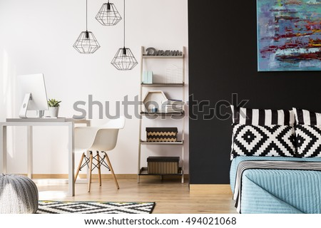 Black and white interior with modern furniture, pattern decorative details and new pendant lamps