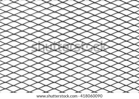 Black and white iron wire fence. - stock photo
