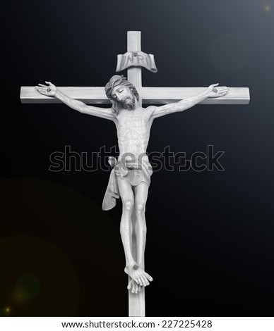 Black and white Jesus christ with the cross. - stock photo