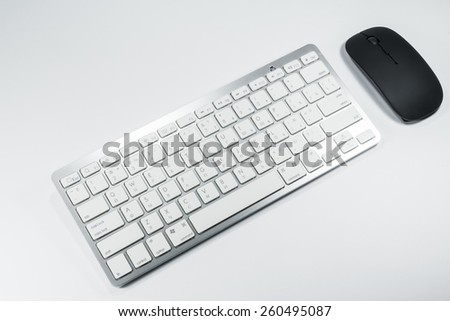 black and white keyboard with  mouse on a white background