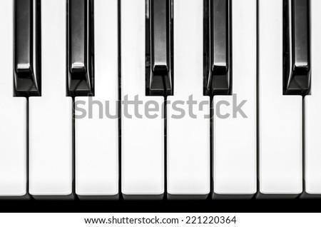 Black and white keys on music keyboard - stock photo