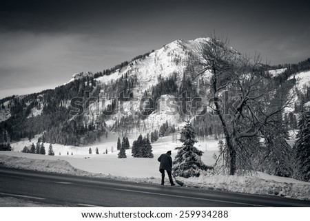 Black and white landscape of high mountains covered by snow at sunny day - stock photo
