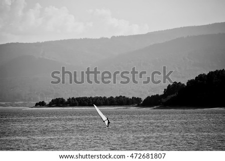 black and white landscape with windsurfer in high mountain bulgarian lake