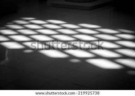black and white light pattern on the floor.