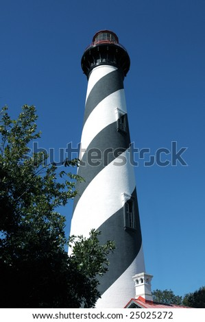 Black and white lighthouse in St Augustine, Florida front view mid afternoon - stock photo